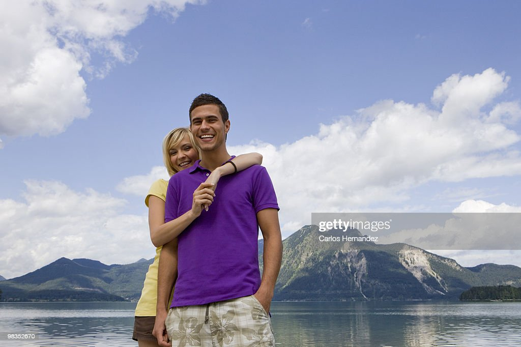 A young couple smiling towards camera : Stock Photo