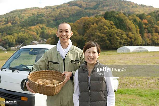 Young couple smiling with potatoes
