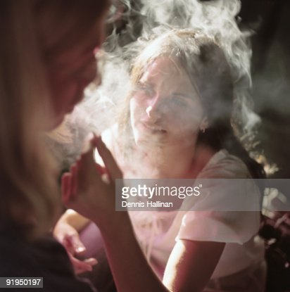 Young couple smoking marijuana