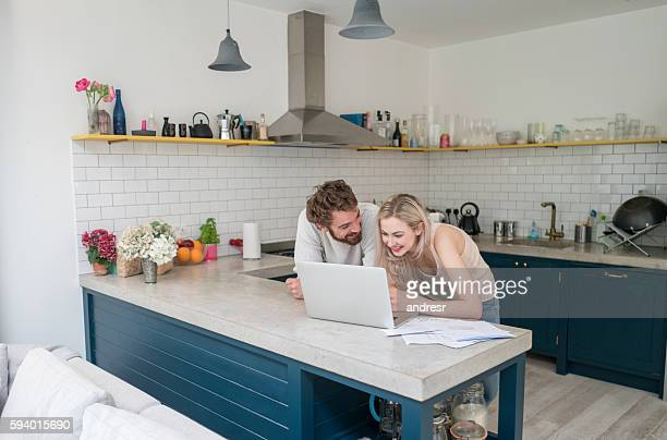Young couple social networking at home