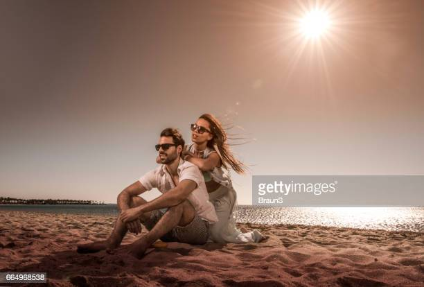 Young couple spending a summer day on the beach.