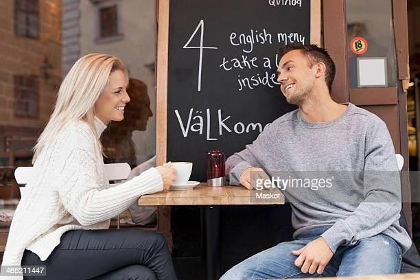 Young couple spending leisure time at outdoor cafe