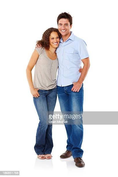 Young Couple Standing Affectionately - Isolated