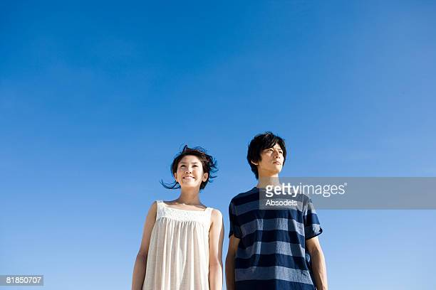 Young couple standing and looking