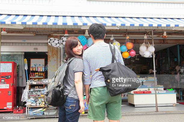 Young couple standing at shop front