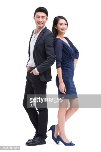 Young couple standing back to back