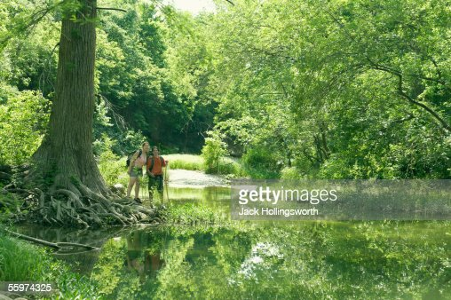 Young couple standing in a forest : Stock Photo