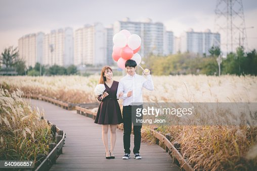 Young couple standing in silver grass field