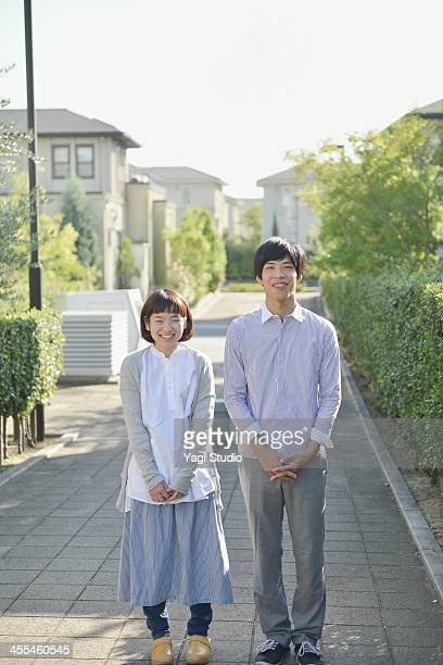 Young couple standing in the residential area