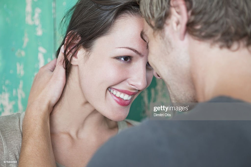 Young couple staring into each others eyes : Stock Photo