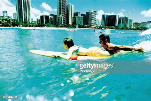 Young couple surfing, Hawaii beach : Stock Photo