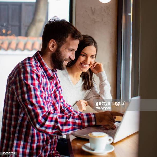 Young couple surfing the net in cafe bar