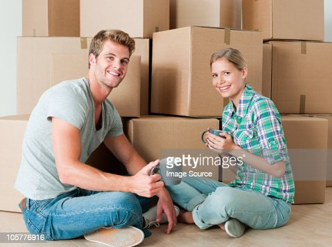 Young couple taking a break from unpacking