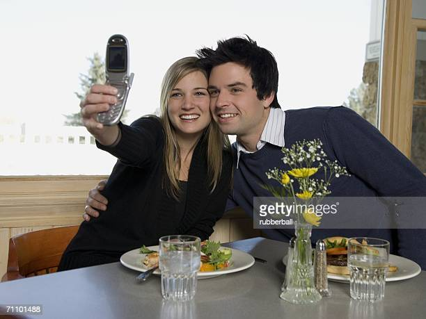 Young couple taking a photograph of themselves