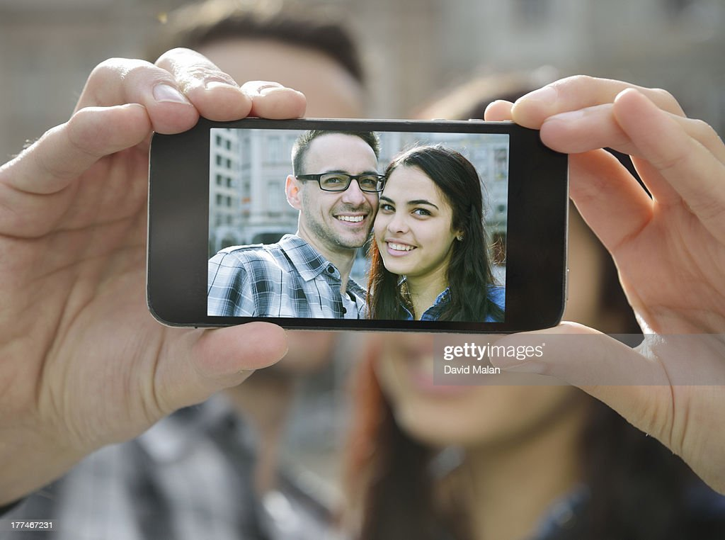 young couple taking a picture of themselves : Stock Photo
