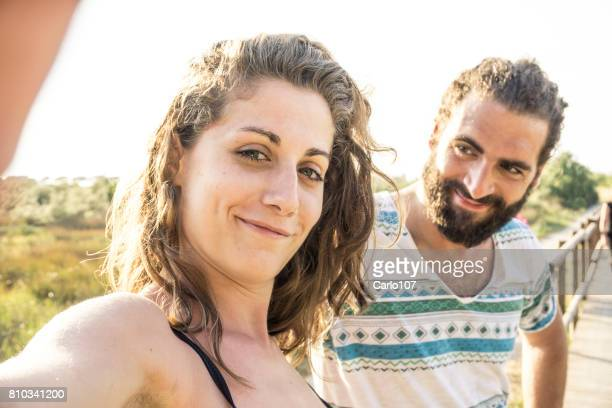Young couple taking a selfie and making funny faces