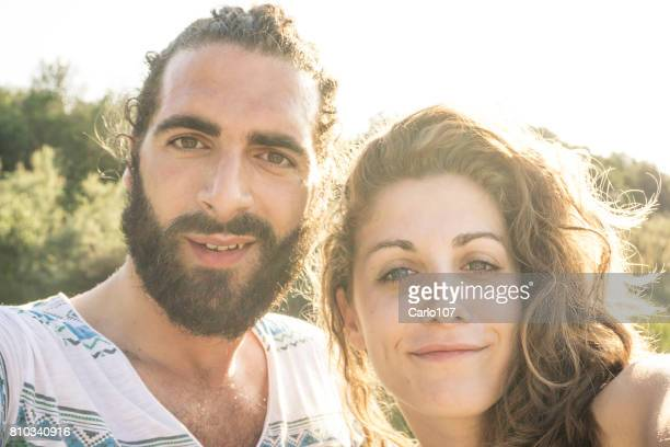 Young couple taking a selfie outdoors