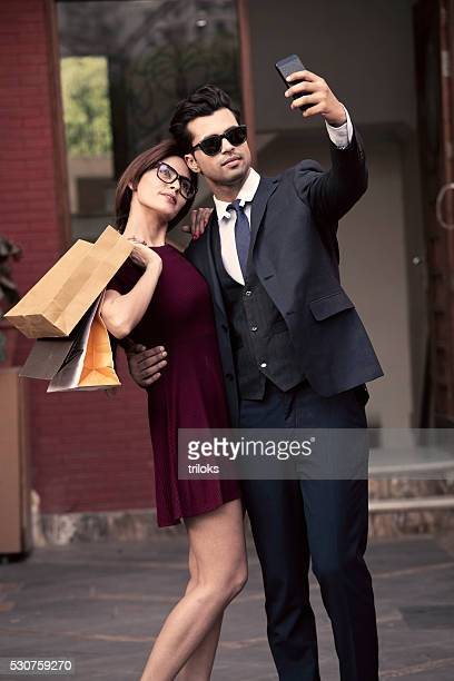 Young couple taking a selfie while shopping
