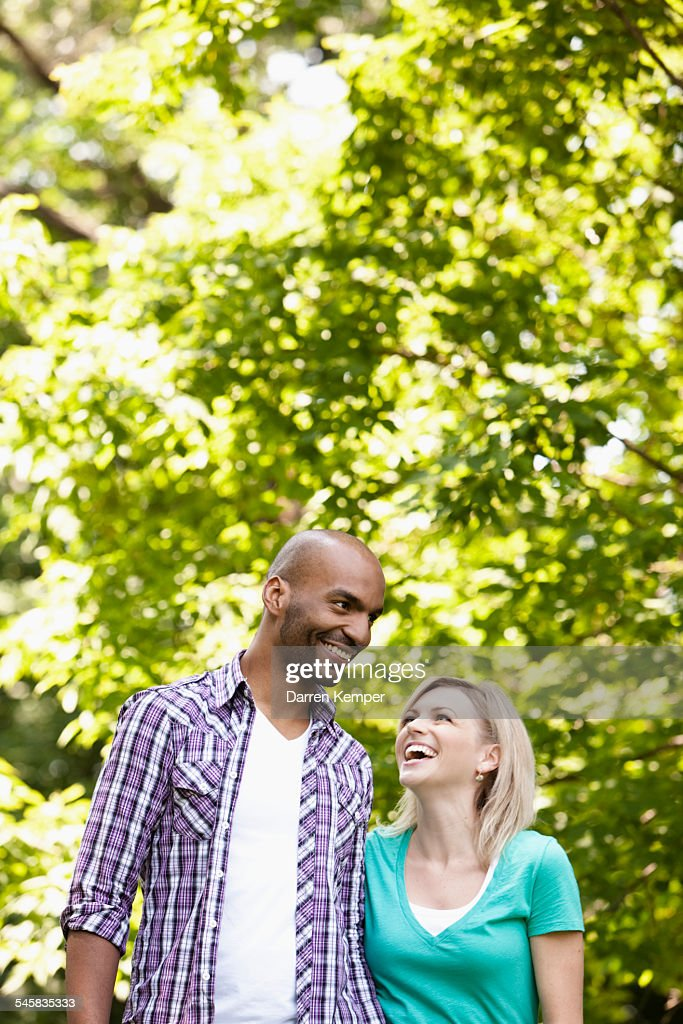 Young couple taking a walk in a park : Stock Photo