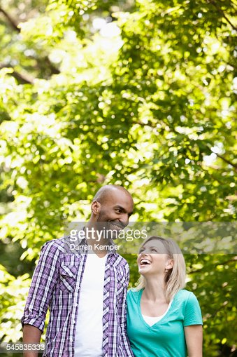 Young couple taking a walk in a park : Stock-Foto