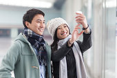 young couple taking photo with a mobile phone