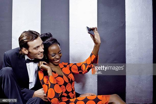 Young couple taking self portrait in nightclub