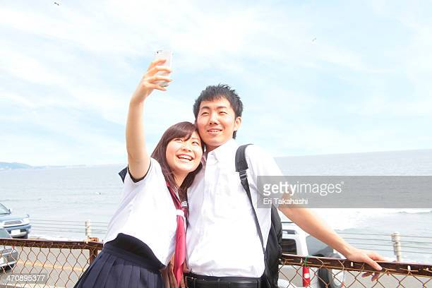 Young couple taking self portrait photograph
