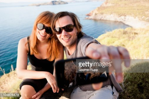 Young couple taking self portrait : Stock Photo