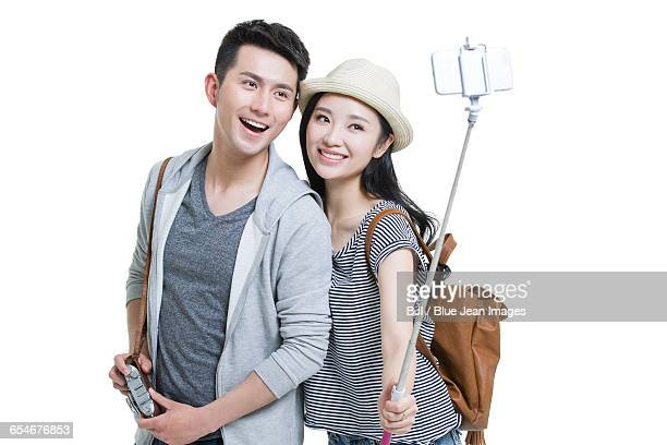 Young couple taking self portrait with a smart phone