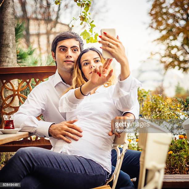 Young Couple Taking Selfie At The Cafe