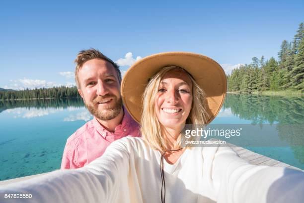 Young couple taking selfie portrait