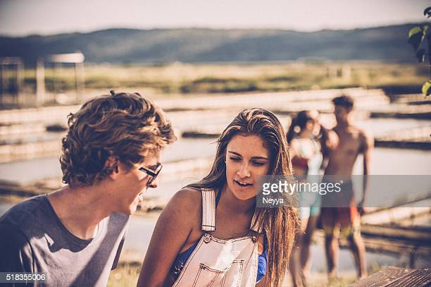Young Couple Talking at Seaside