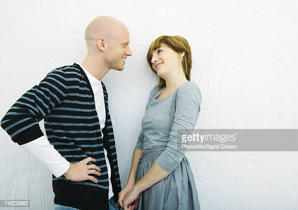 Young couple talking, side view