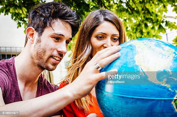 Young Couple Thinking About Where To Go On Trip