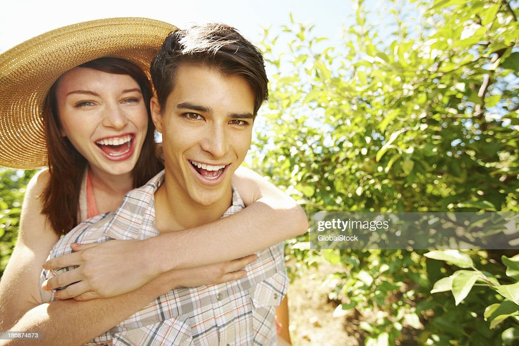 Young couple together in park : Stock Photo