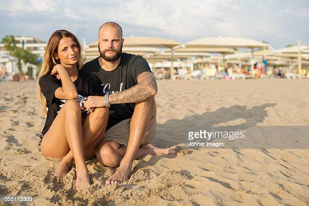 Young couple together on beach