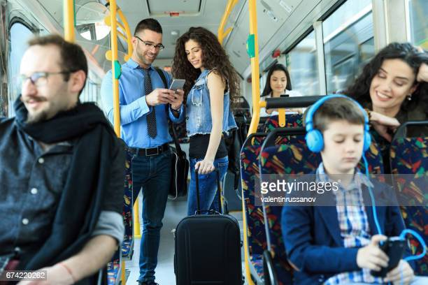 Young couple traveling and using smart phone