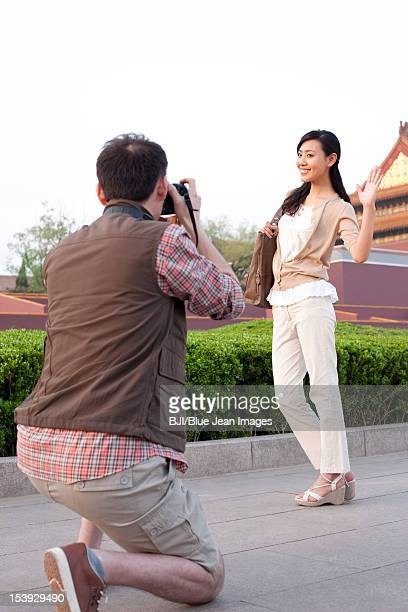 Young couple travelling at Tiananmen Square in Beijing, China
