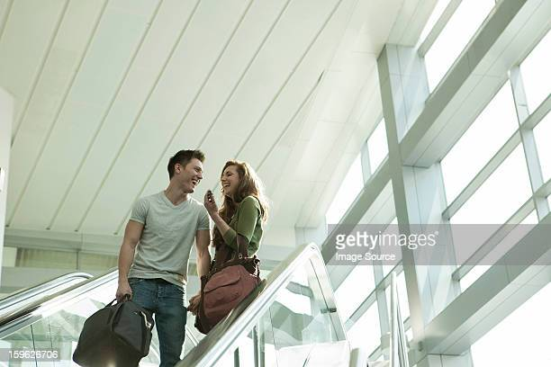Young couple travelling on escalator