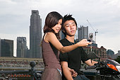 Young couple using a camera telephone