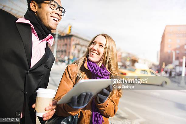 Young couple using digital tablet in New York, USA