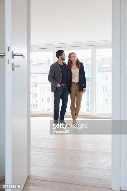 Young couple viewing new flat