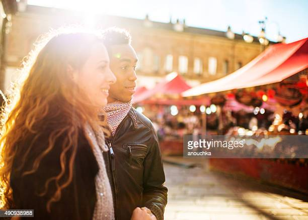 Young Couple visiting Christmas Market in Milan