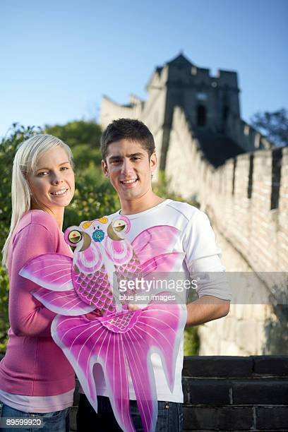 Young couple visiting the Great Wall of China
