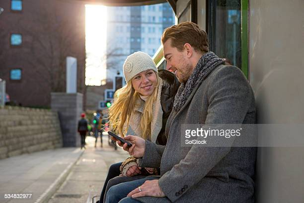 Young Couple Waiting at the Bus Stop