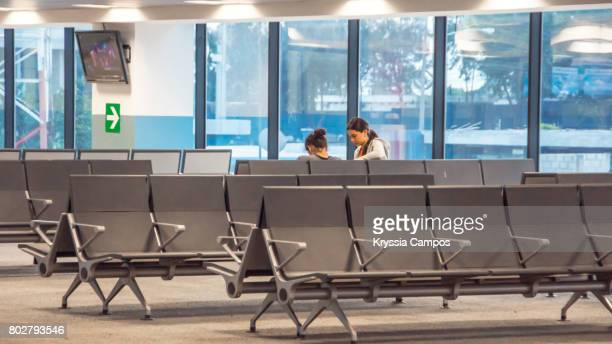 Young couple waiting for flight at airport lounge