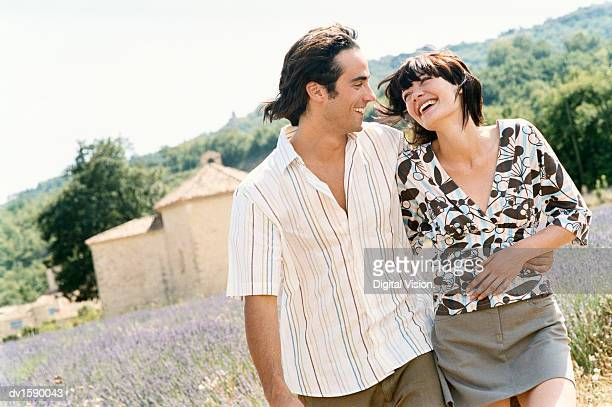 Young Couple Walk Side by Side Laughing in a Lavender Field, Provence, France
