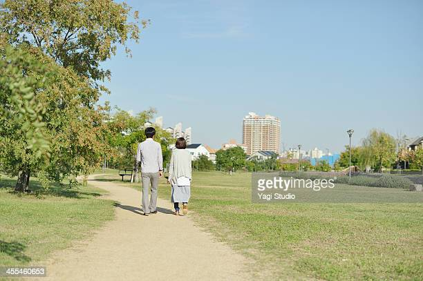 Young couple walking down the street in the park