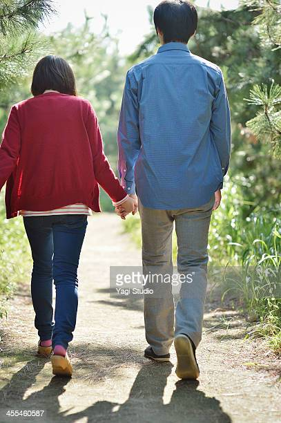 Young couple walking  full of green