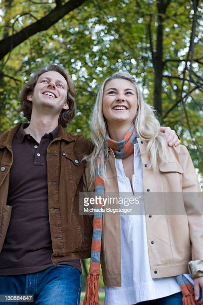 Young couple walking in an autumnal park